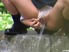 In a garden area, these school girls don't need a bathroom, they unassisted bend down and water in the woods. As PissJapanTV.com films, they drop their dew.